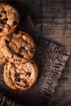 Chocolate chip cookies,  freshly baked on rustic wooden table. Selective Focus. Copy space.
